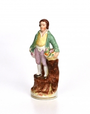 Staffordshire Figure of a Boy with Flowers
