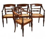 Four British Colonial Hardwood Open Armchairs